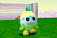 A Chao wearing an eggshell as a hat